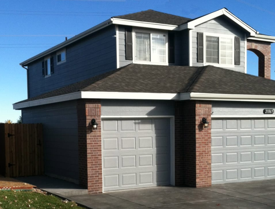 Adding an Attached 12x 24 One Car Garage with Brick & Lap Siding