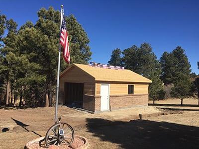 "Simple Custom Built Detached Garage - 22x24, gable roof, brick wainscot with cedar siding, 4/12 pitch, 12"" overhangs"